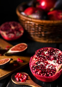 High angle of autumn figs and pomegranate