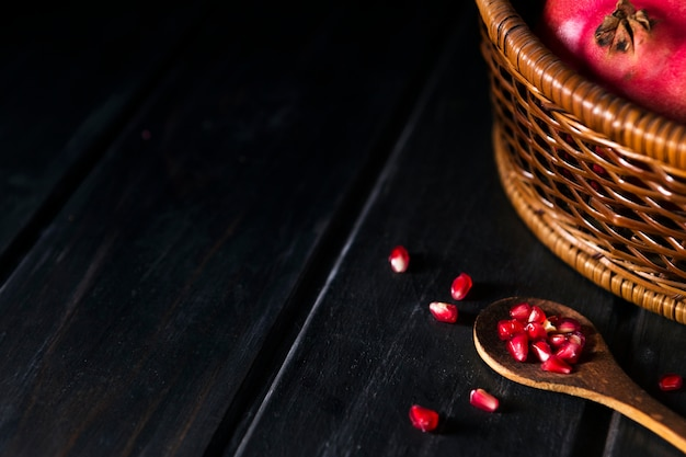 High angle of autumn pomegranate seeds with copy space