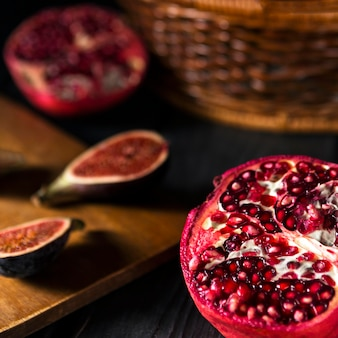 High angle of autumn pomegranates and figs