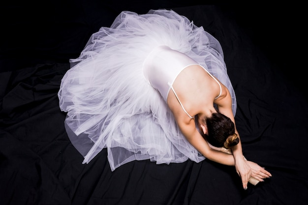 High angle ballerina on dark background