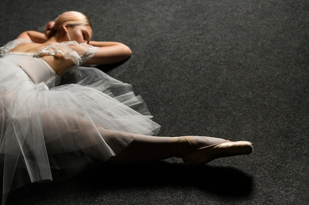 High angle of ballerina in tutu dress doing a split