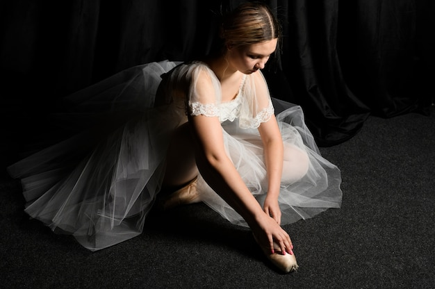 High angle of ballerina in tutu dress looking down