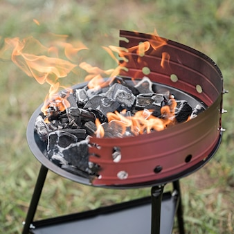 High angle of barbecue outdoors with fire