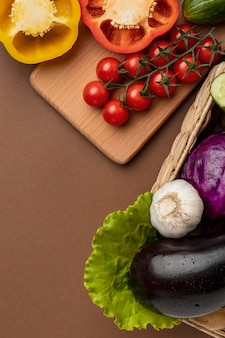 High angle of basket of organic vegetables
