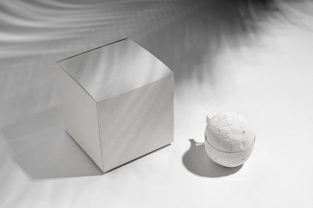High angle bath bomb next to white box