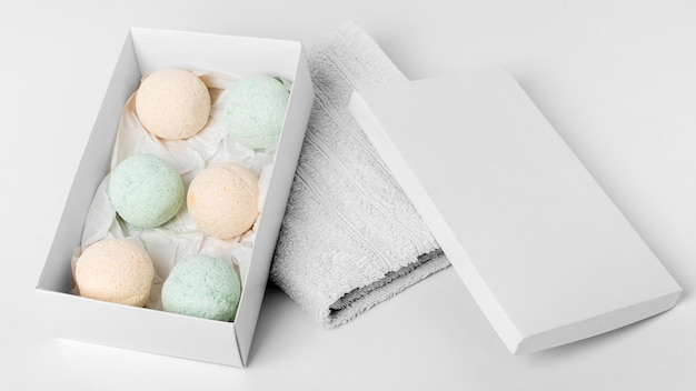 High angle bath bombs box on white towel