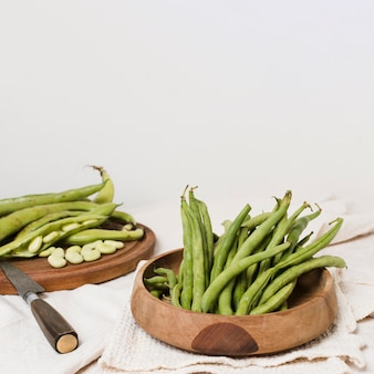 High angle of beans in bowl with knife and copy space