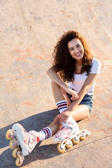 High angle beautiful girl with curly hair posing