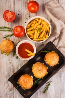 High angle beef burgers with delicious fries