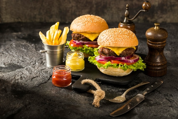 High angle beef burgers with fries and sauce