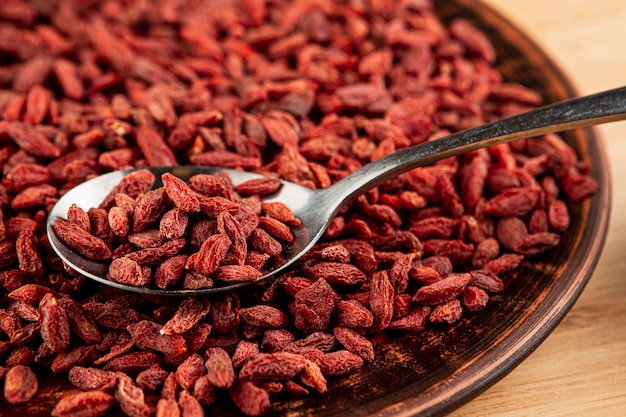High angle big bowl with goji berries and wooden background