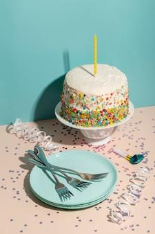 High angle birthday cake and cutlery