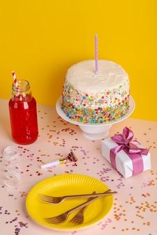 High angle birthday cake and gift