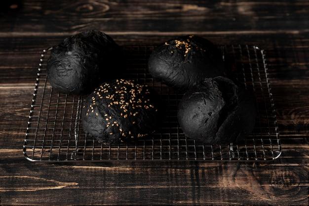 High angle black bugrer buns on tray