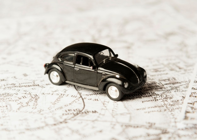High angle black toy car on map