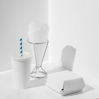 High angle blank cup and burger packaging with tissue folder