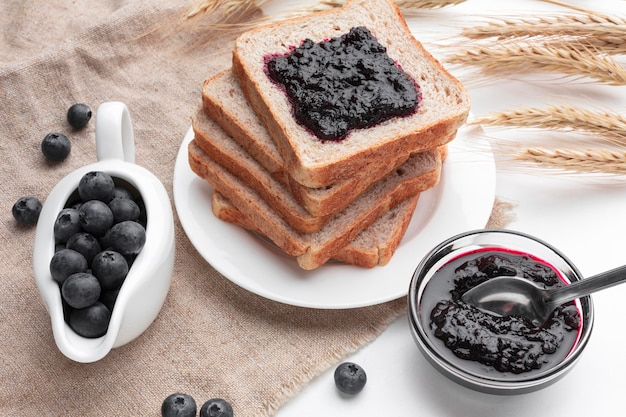 High angle blueberry jam on bread