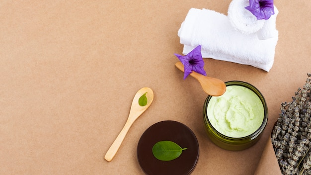 High angle of body butter on plain background with copy space