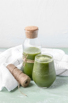 High angle bottle and glass with smoothie