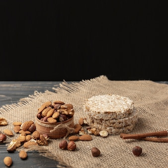 High angle of bowl with almonds and other nuts with copy space