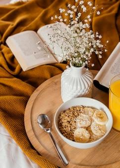 High angle bowl with cereal and banana slices