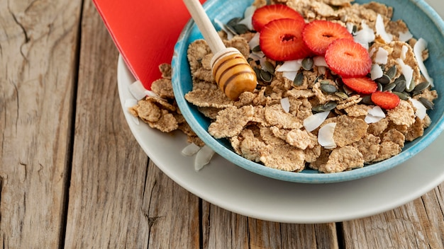 High angle of bowl with fruits and breakfast cereals