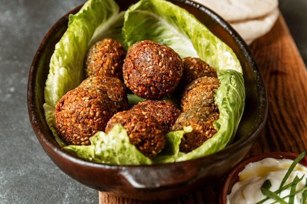 High angle bowl with lettuce and falafel
