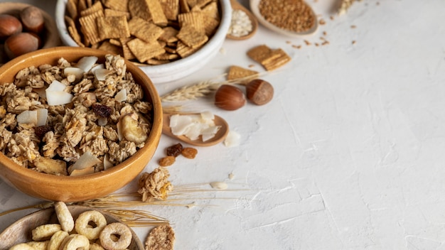 High angle of bowls with assortment of breakfast cereals and copy space