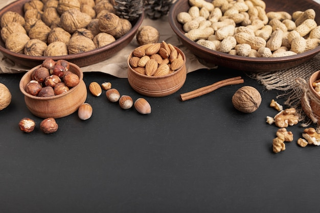 High angle of bowls with hazelnut and other nuts