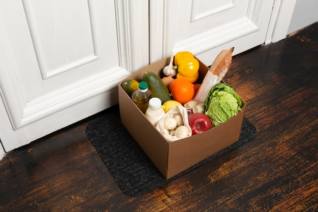 High angle box with vegetables on mat