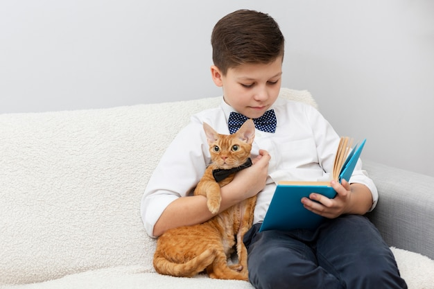 High angle boy with cat reading