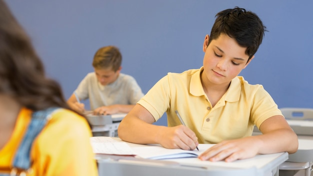 High angle boy writing
