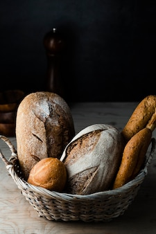High angle of bread in a basket on wooden table