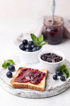 High angle bread with blueberry jam