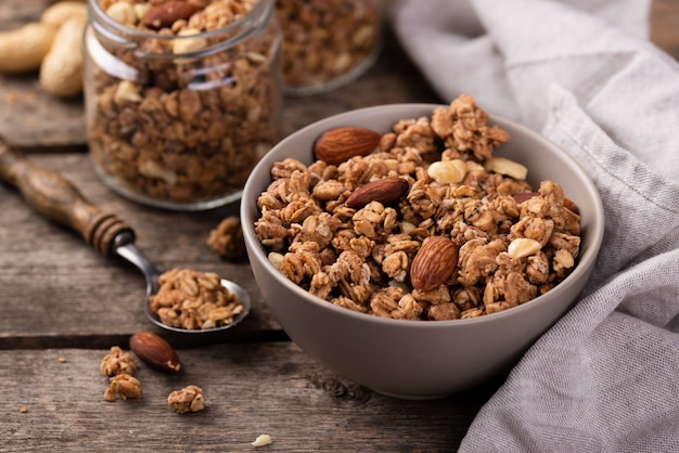 High angle of breakfast cereal in bowl with nuts