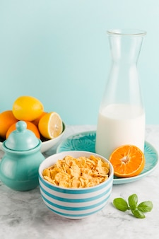 High angle breakfast with cornflakes and citrus