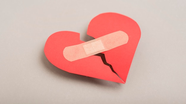 High angle broken heart with band-aid