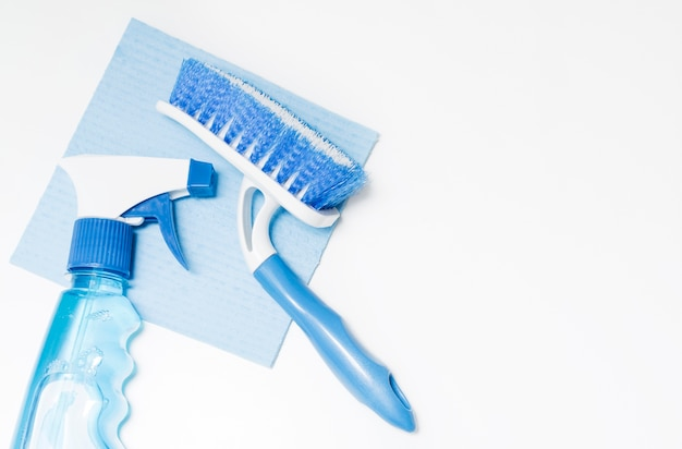 High angle of brush with cleaning product and copy space