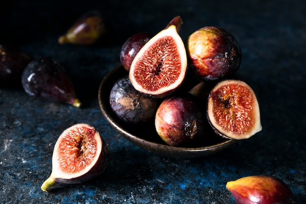 High angle of bunch of autumn figs on plate