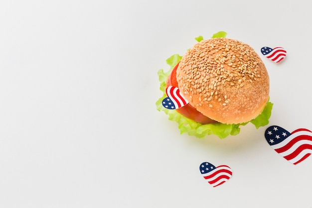 High angle of burger with american flags and copy space