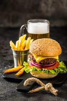High angle burger with fries and beer