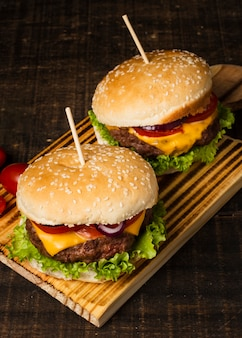 High angle of burgers on wooden tray