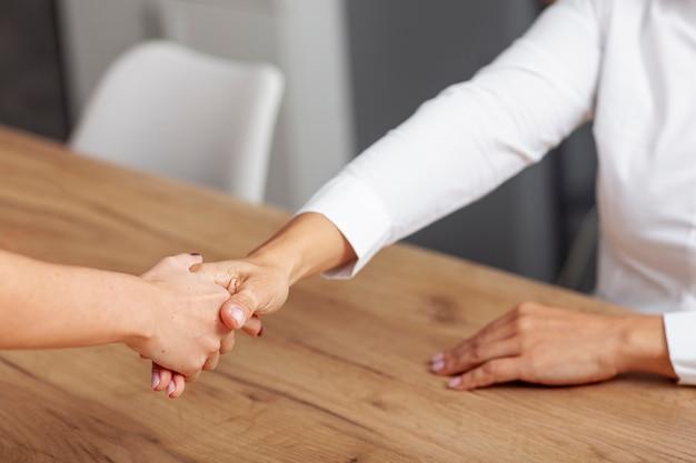High angle business handshake agreement