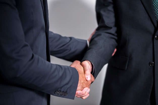 High angle business handshake collaboration