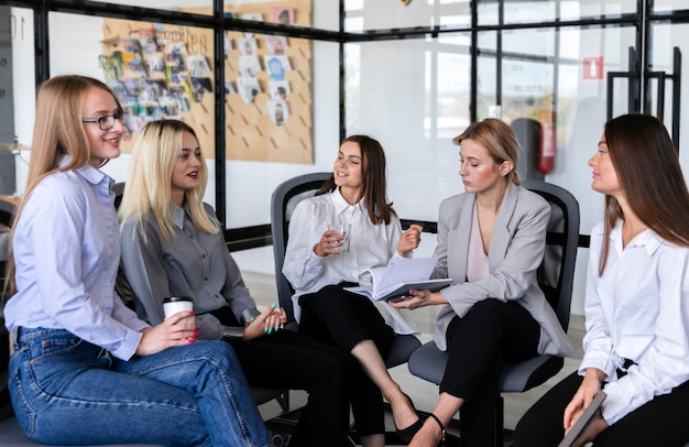 High angle business meeting with women