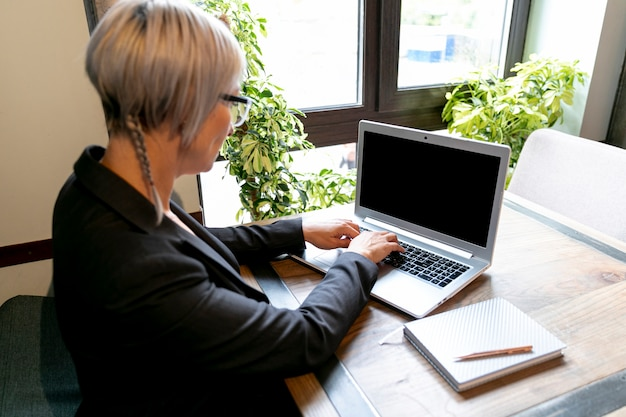 High angle business woman working on laptop