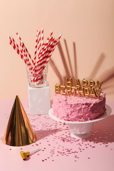 High angle cake and birthday candles assortment