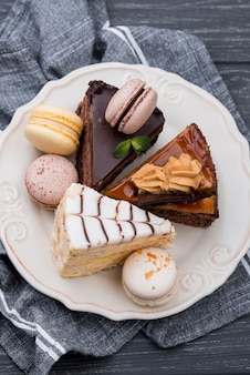 High angle of cakes on plate with macarons