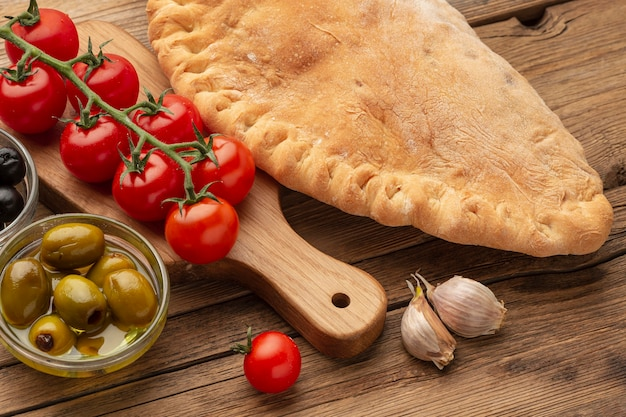 High angle calzone, tomatoes and olives
