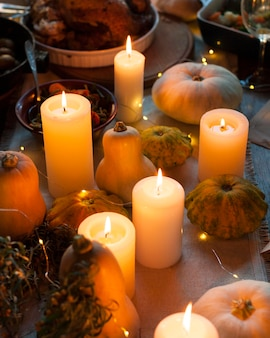 High angle candles and pumpkins